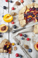 galette with sliced apricots peaches and blueberries