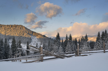 Winter landscape with a fence