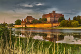 Fototapety HDR image of medieval castle in Malbork at night with reflection