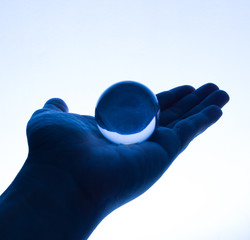 Glass Ball on Hand in Tungsten Light