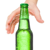 Hand trying to grasp bottle of beer - studio shot - 1 to 1 ratio poster