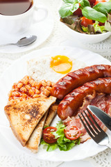Full English breakfast with bacon, sausage, fried egg and beans
