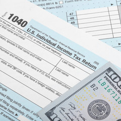 US Tax Form 1040 with two 100 dollars banknotes - 1 to 1 ratio