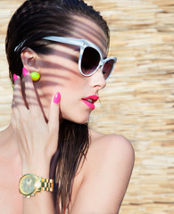 Young attractive elegant brunette woman wearing sunglasses