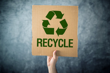 RECYCLE. Man holding cardboard with Recycle symbol printed