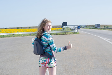 girl hitchhiking