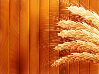 Wheat on wooden autumn background. EPS 10