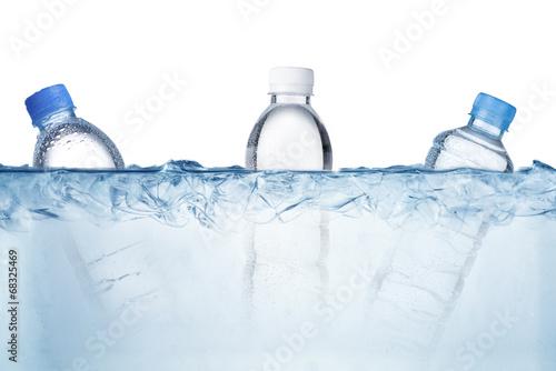 water bottles in ice cubes © somchaij