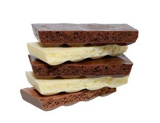 Black and white porous chocolate on white background