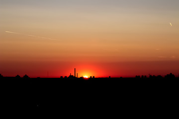 Beautiful sunrise over silhouette of the city.