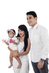 Attractive asian family in studio