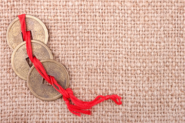 Chinese Coins on the Burlap Background