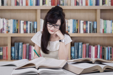 Beautiful student studying in the library