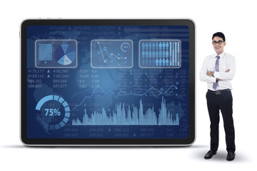 Businessman and business graph on screen