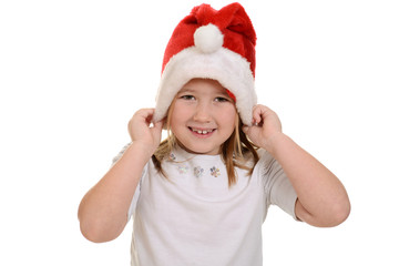 little girl putting on santa hat