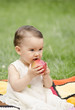 Cute baby eating an red apple