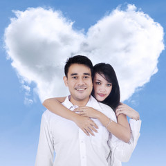 Couple and heart shaped cloud