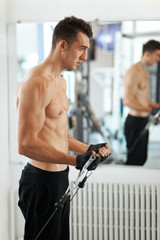 man exercising in trainer for triceps muscles