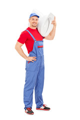 Plumber carrying a toilet bowl