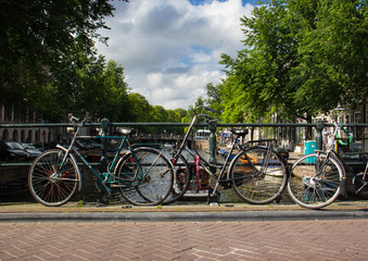 Bikes on the bridge in Amsterdam Netherlands