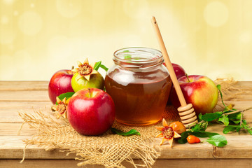 Honey jar with apples and pomegranate for Jewish New Year