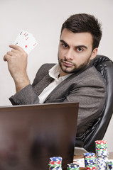 Elegant poker player in a suit playing online