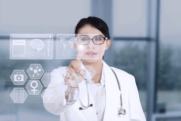 Female doctor using modern technology