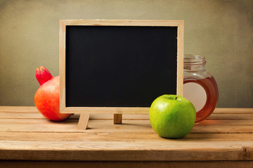 Chalkboard with honey and apple for Jewish New Year Holiday