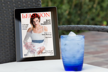 fake fashion magazine cover on a tablet in the garden