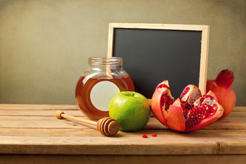 Honey, apple and pomegranate with chalkboard