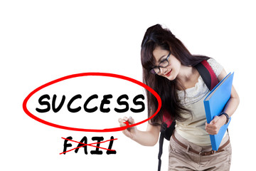 Female student writes motivation word
