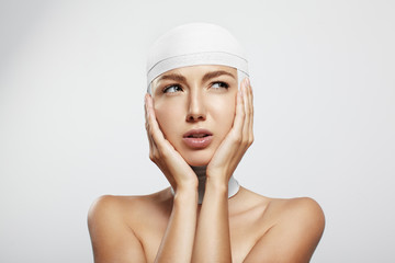 beauty young woman with bandaged head