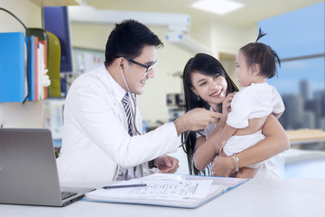 Male pediatrician and his patient 2