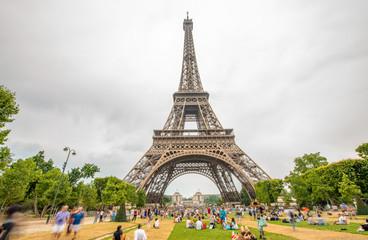 PARIS - JUNE 21, 2014: Tourists enjoy Eiffel Tower view from Cha