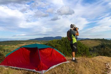 Man take a photograph, camping