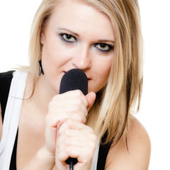 Music. Girl singer musician singing to microphone