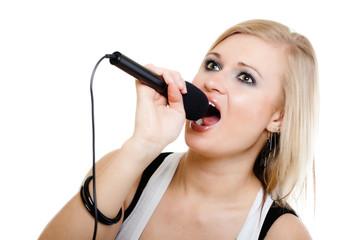 Music. Girl singer musician singing to microphone