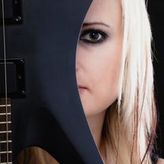 Rock music. Girl musician guitarist with electric guitar
