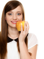 Diet. Girl offering apple seasonal fruit.