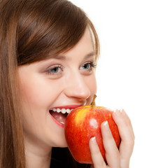 Diet. Girl eating biting apple seasonal fruit.