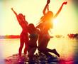 Beach party. Teenage girls having fun in water