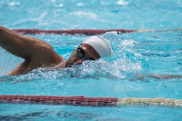 free style swimmer on sun light
