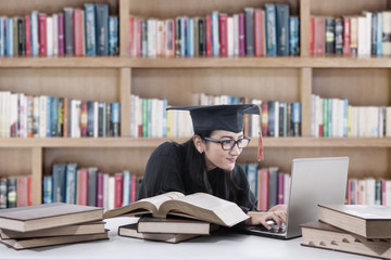 Young bachelor studying in library 3