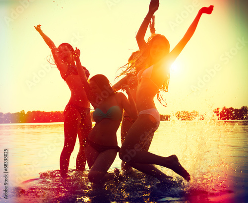 Beach party. Teenage girls having fun in water