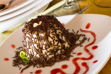 "Italian Dessert called ""panna Cotta"" with chocolate and strawber"