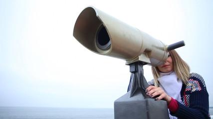 Woman looking through the binoculars. Full HD  motorized slider