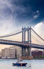Boat under Manhattan Bridge