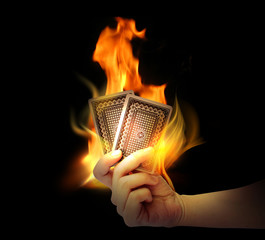 Cards on fire in a hand (Gambling)