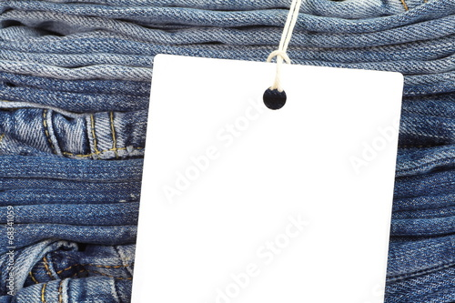 canvas print picture Close - up Blue jeans detail with blank white tag