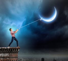 Man catching moon